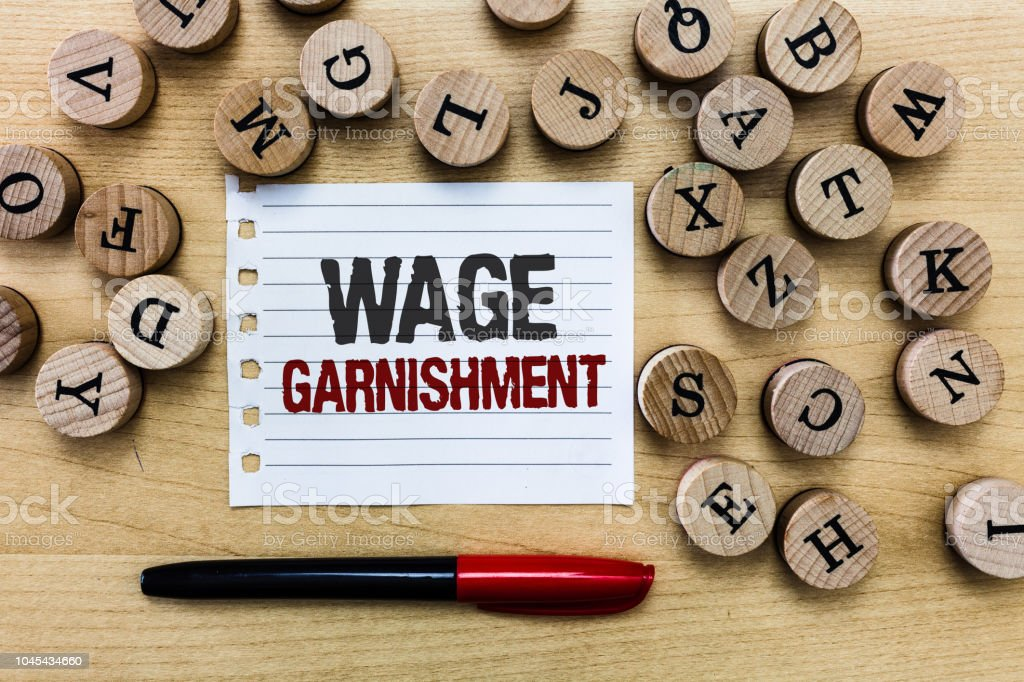 Word writing text Wage Garnishment. Business concept for Deducting money from compensation ordered by the court stock photo