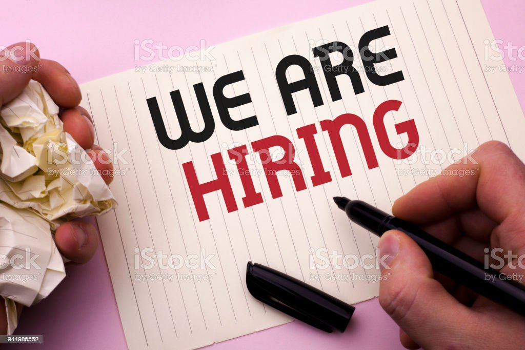 Word writing text We Are Hiring. Business concept for Talent Hunting Job Position Wanted Workforce HR Recruitment written by Man on Notebook Paper Holding Marker on the plain background. stock photo