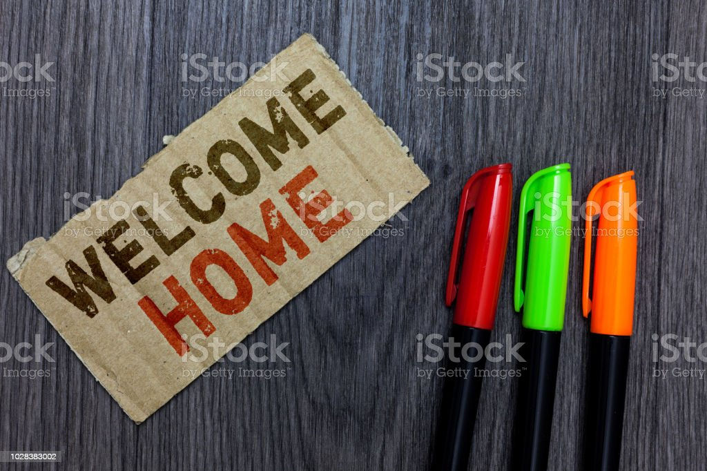 Word writing text Welcome Home. Business concept for Expression Greetings New Owners Domicile Doormat Entry Paperboard Important reminder Communicate ideas Markers Wooden background stock photo