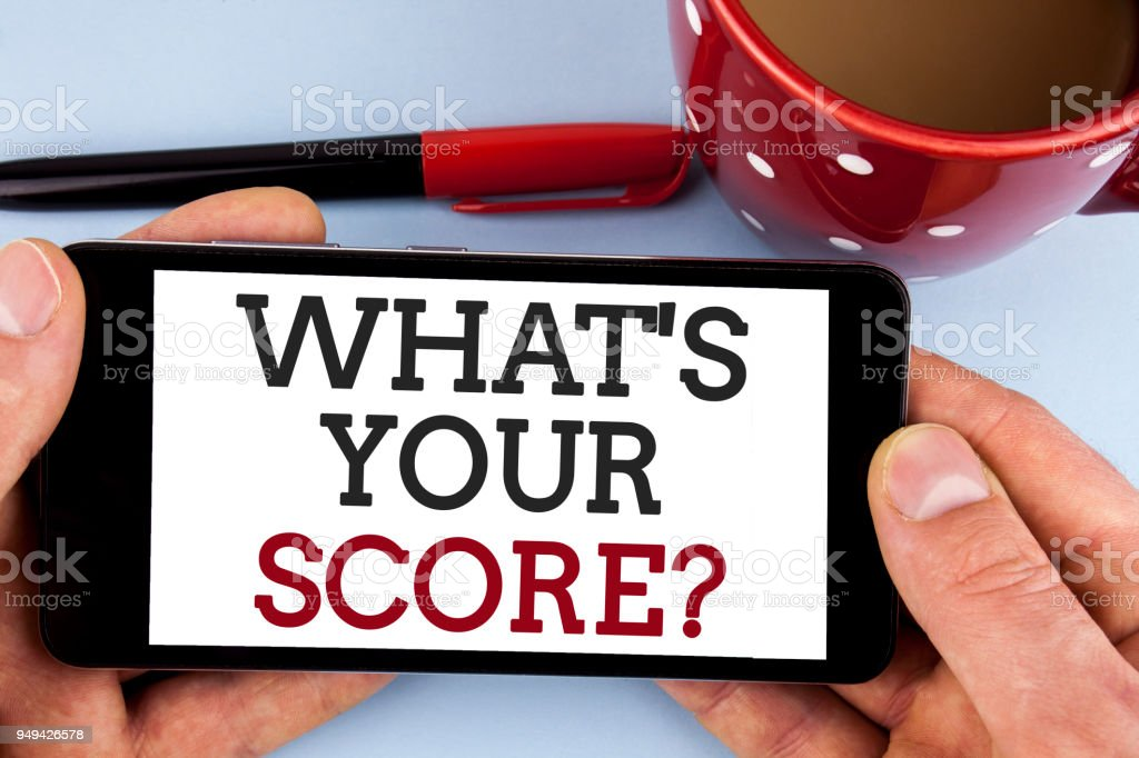 Word writing text What Is Your Score Question. Business concept for Tell Personal Individual Rating Average Results written on Mobile Phone Screen holding by man on the plain background Cup Marker stock photo
