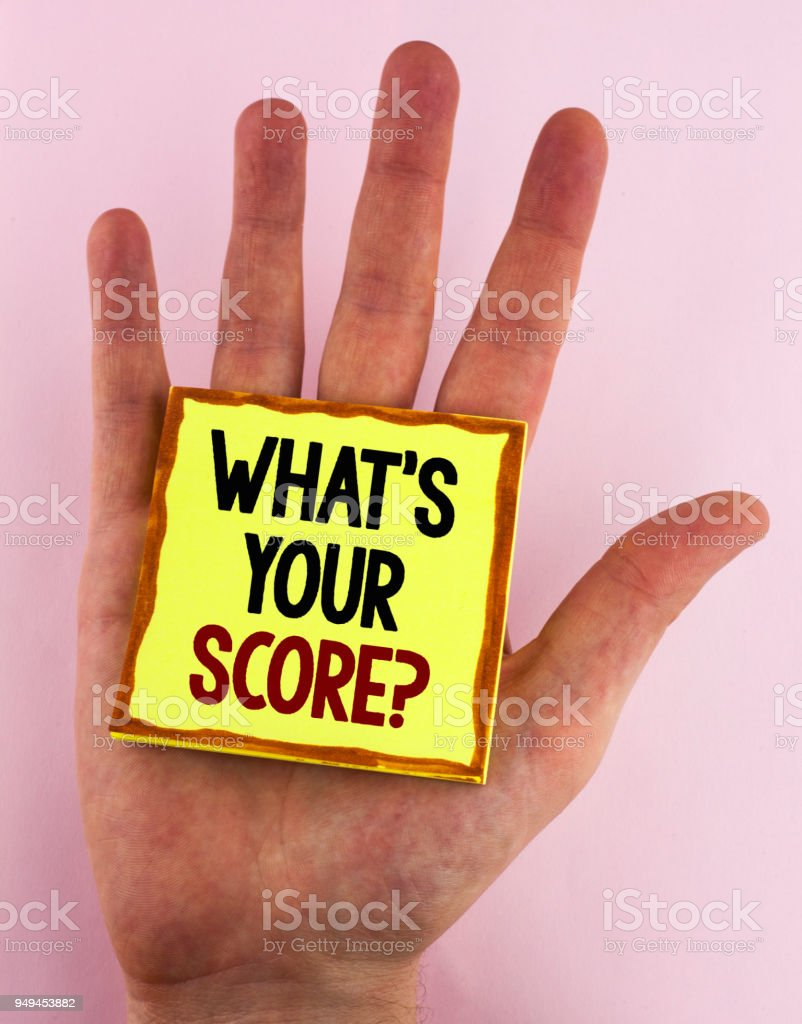 Word writing text What Is Your Score Question. Business concept for Tell Personal Individual Rating Average Results written on Sticky Note Paper placed on the Hand on the plain background. stock photo