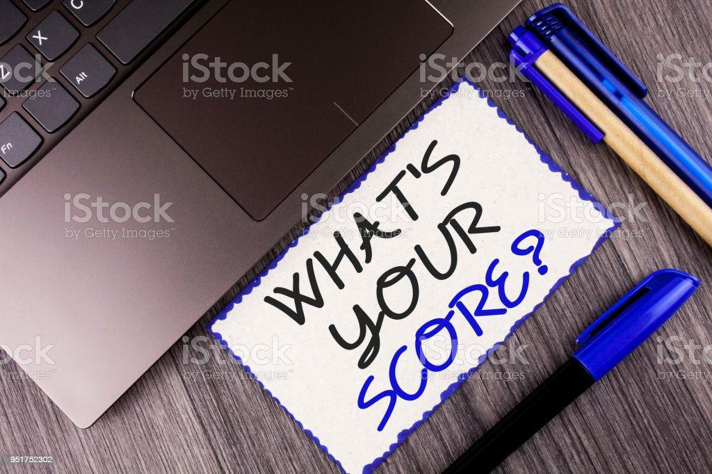 Word writing text What Is Your Score Question. Business concept for Tell Personal Individual Rating Average Results written on White Sticky Note Paper on the wooden background Laptop Markers stock photo