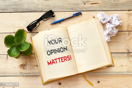 Word writing text Your Opinion Matters on open notebook