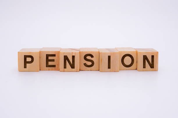 PENSION Word Written In Wooden Cube stock photo