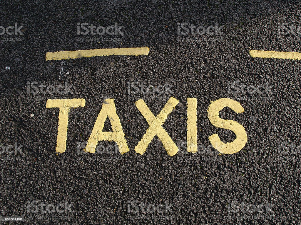TAXIS - word written on the traffic lane stock photo