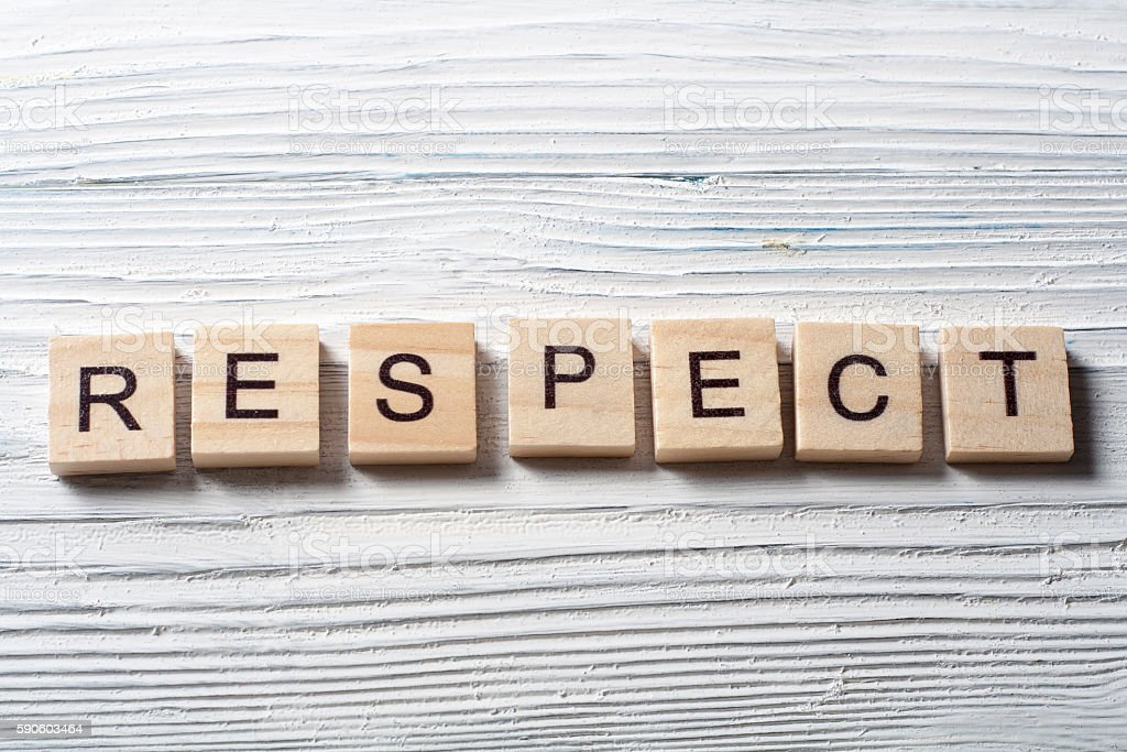RESPECT word written on wood block ta wooden background stock photo