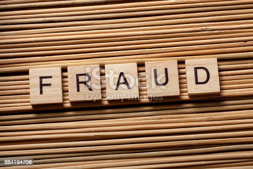 922107104istockphoto FRAUD word written on wooden cubes. Finance Concept. Money 884194708