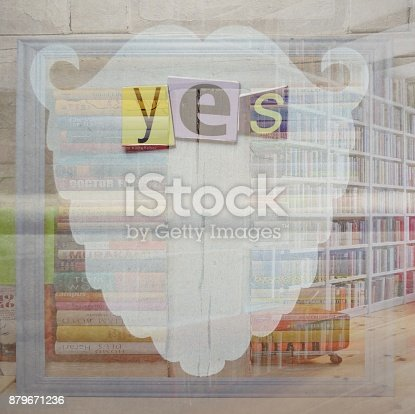 istock Word yes lying on santa shaped face over library 879671236