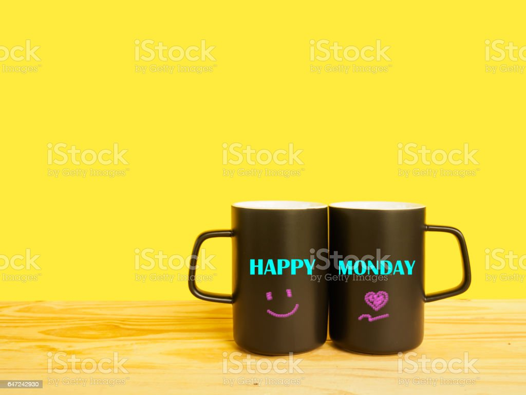 Wording Happy Monday On Couple Coffee Cup On Desk Of Yellow