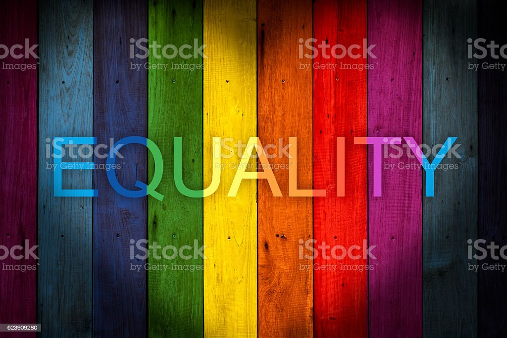 EQUALITY Wording LGBT concept color wood background stock photo