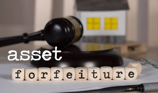 Words  ASSET FORFEITURE composed of wooden dices. stock photo