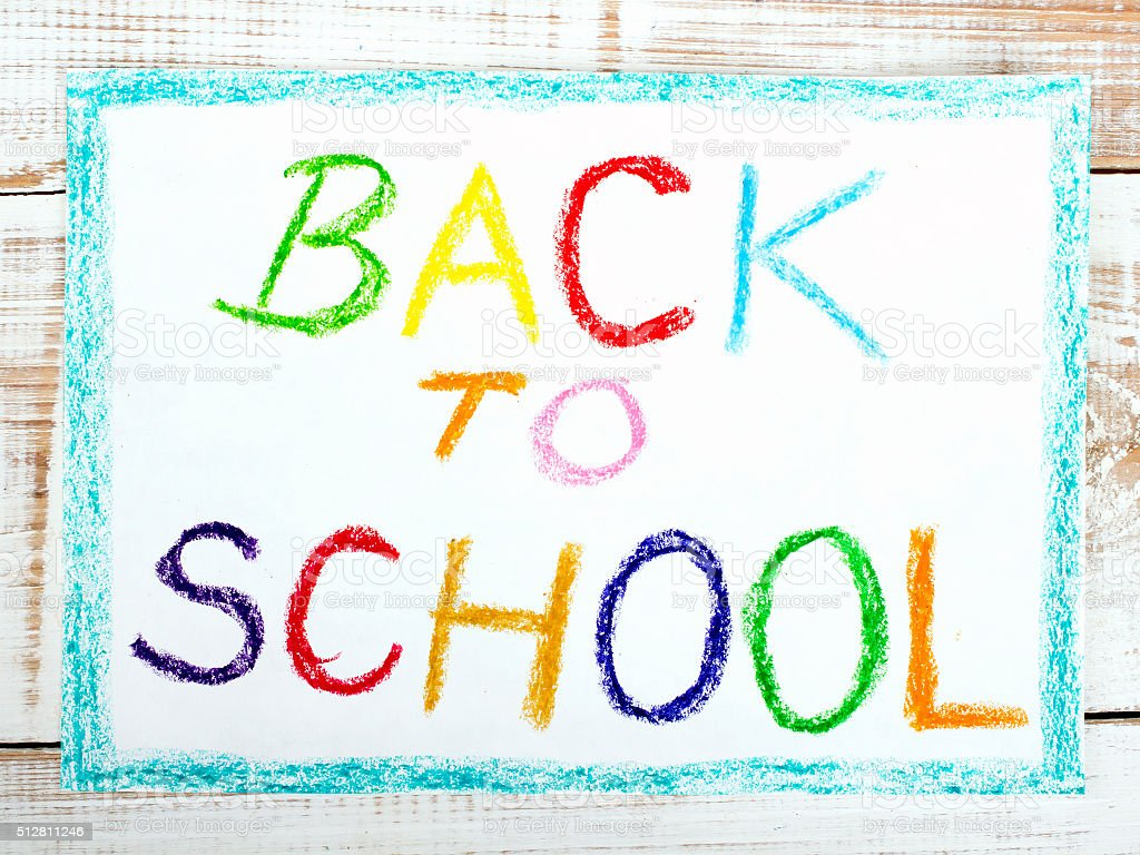 words BACK TO SCHOOL written in blue crayon on paper royalty-free stock photo