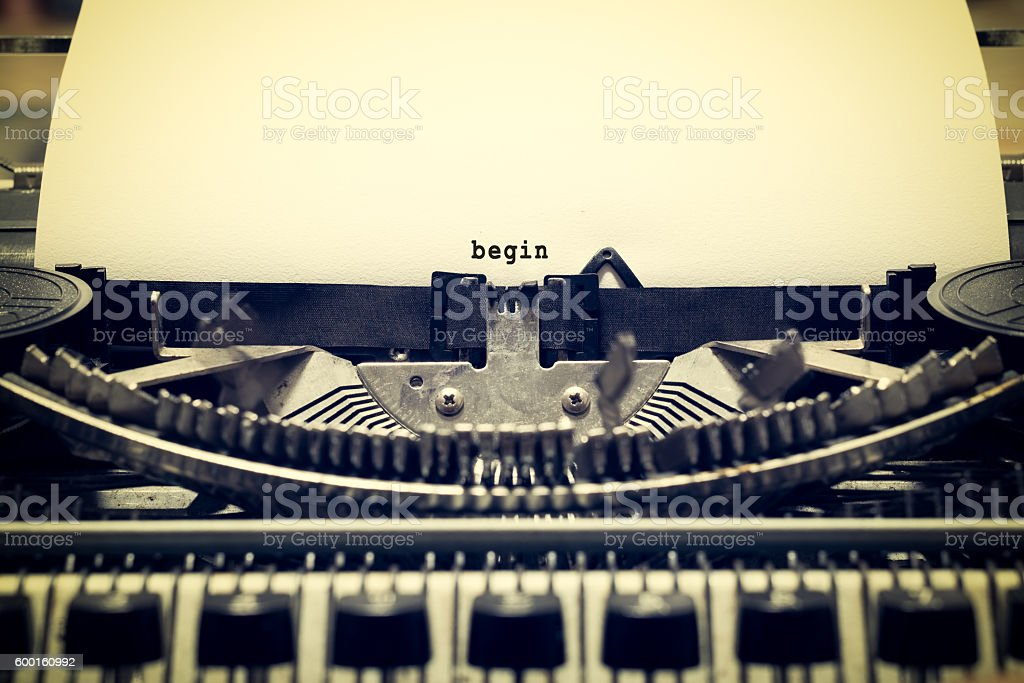 Words 'begin' written with old typewriter stock photo