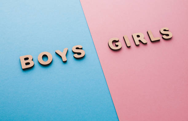 words boys and girls on bright backgrounds - gender stereotypes stock pictures, royalty-free photos & images