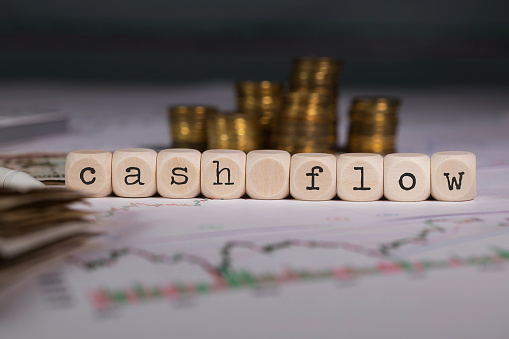 Words Cash Flow Composed Of Wooden Letters Stock Photo - Download Image Now