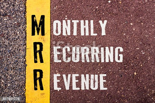 MONTHLY RECURRING REVENUE , words concept on Asphalt with Yellow Dividing Line.