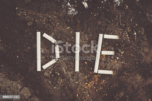 istock words DIE made with broken cigarettes and tobacco. 886051232