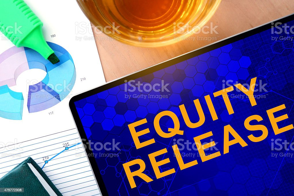 Words Equity Release on the tablet and charts. stock photo