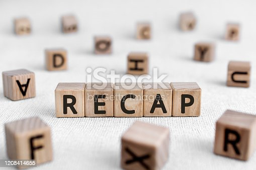 RECAP - words from wooden blocks with letters, a summary of what has been said; a recapitulation RECAP concept, white background