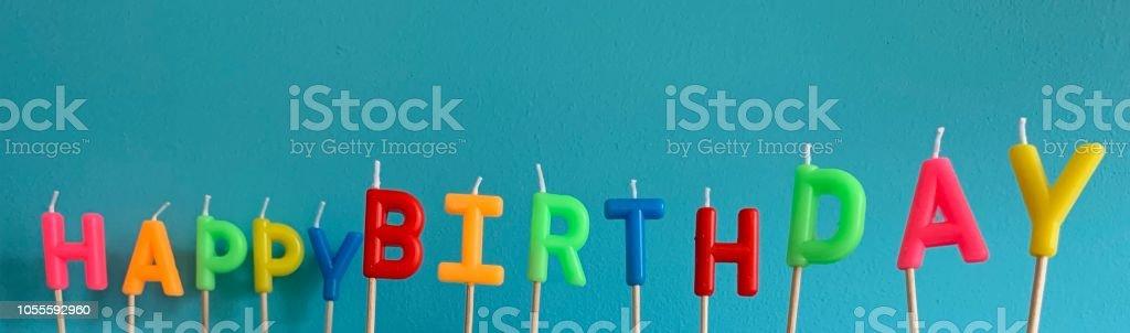 Words happy birthday on blue background