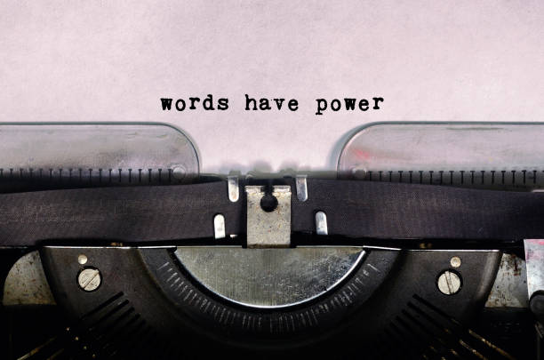 words have power text type on vintage typewriter - forza foto e immagini stock