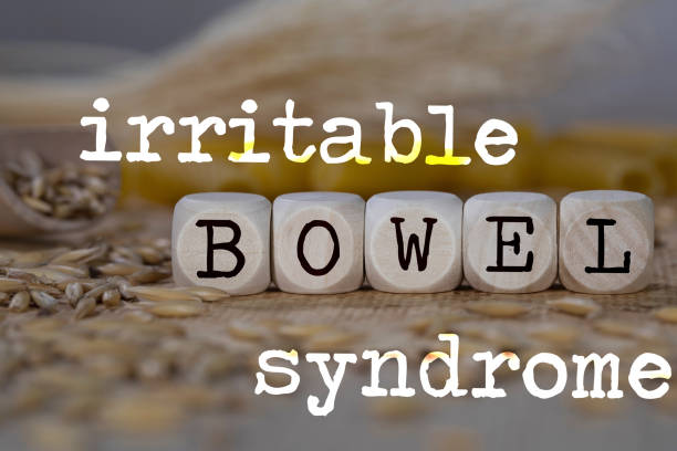 Words IRRITABLE BOWEL SYNDROME composed of wooden dices. stock photo