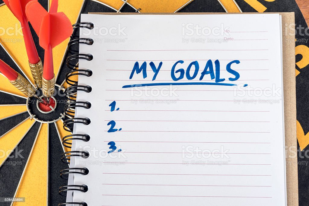 Words my goals on notebook with dart target background stock photo