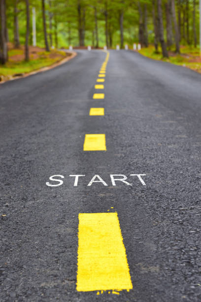 Words of start with yellow line marking on road surface Transportation concept and business idea starting line stock pictures, royalty-free photos & images
