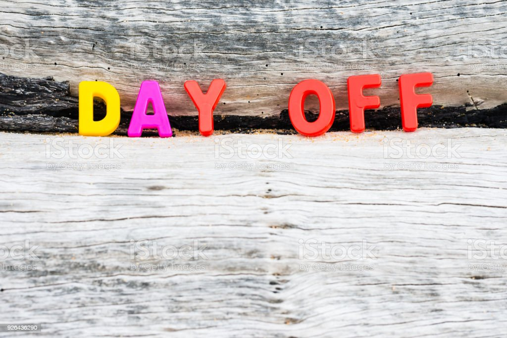 'DAY OFF' words on wood background stock photo