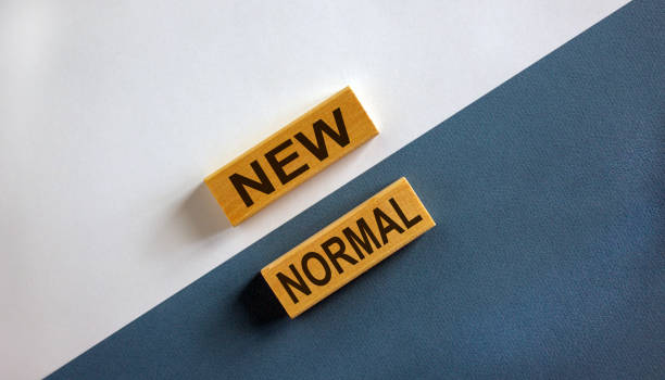 new normal words on wooden blocks. new normal concept. beautiful wooden background. - new normal foto e immagini stock