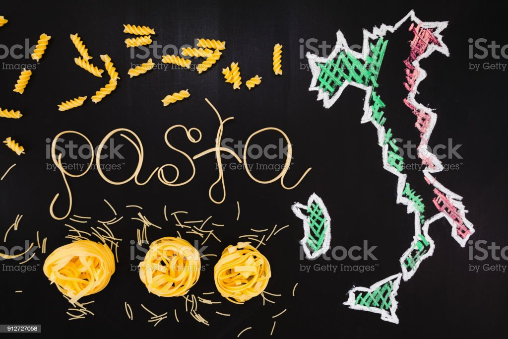 words pasta made of cooked spaghetti and dry pasta on the black