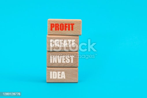 Words profit, create, invest, idea on toy blocks.