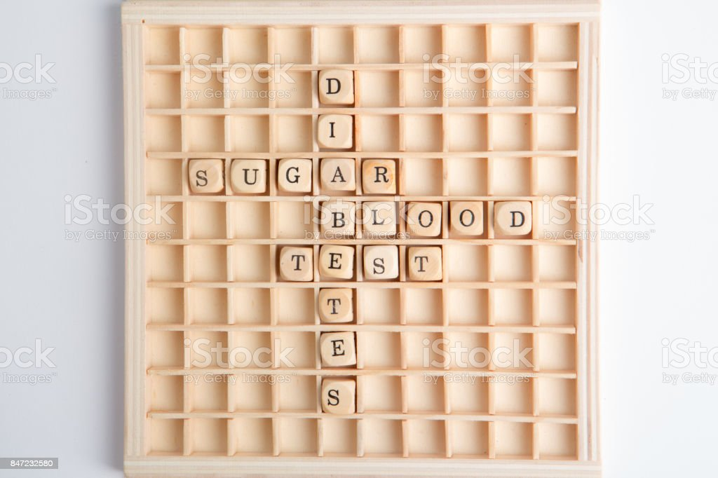 Words relating to diabetes on board game stock photo