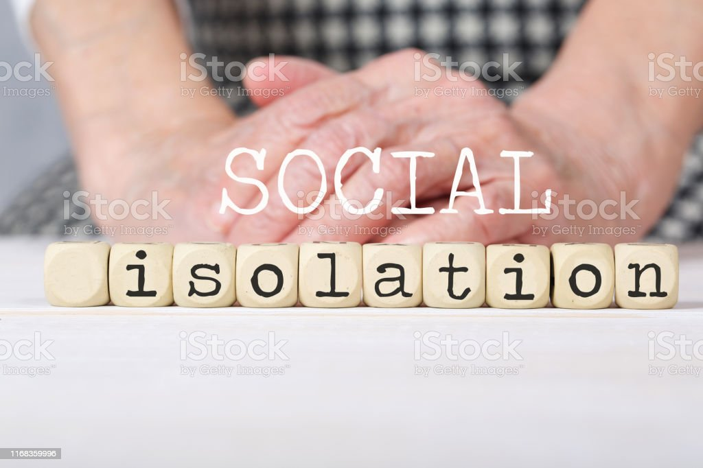 Words SOCIAL ISOLATION composed of wooden made dices. Closeup