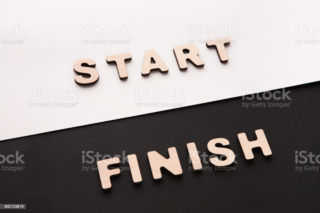 Words Start and Finish on contrast background stock photo