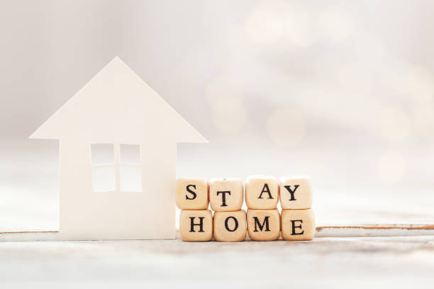 words stay at home made of wooden blocks and white paper house , social distancing. - prevenzione delle malattie foto e immagini stock