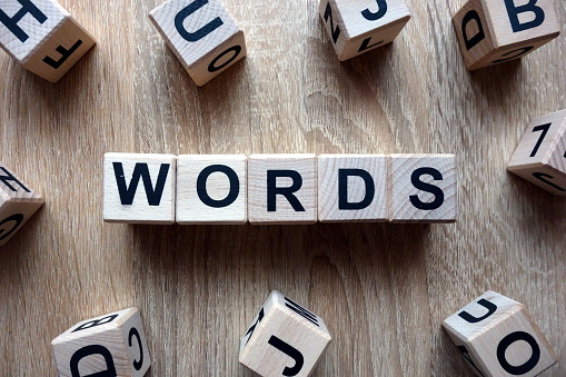 Words text from wooden blocks on desk