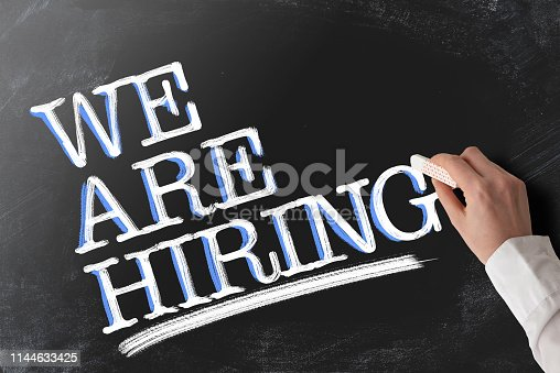 1153648747istockphoto words WE ARE HIRING recruiting concept on chalkboard 1144633425