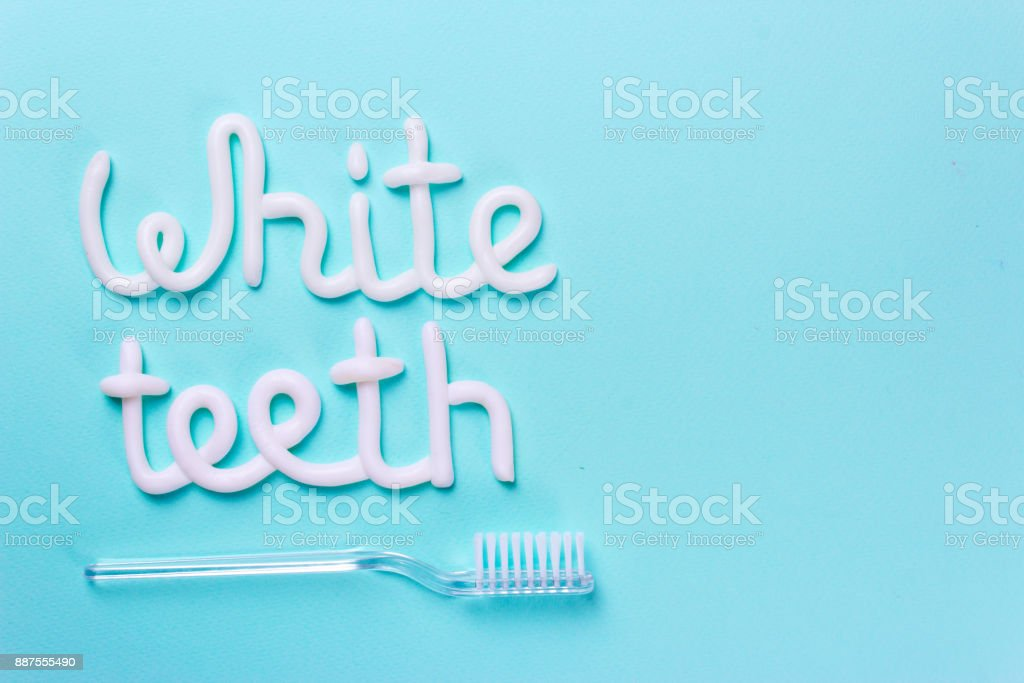 Words white teeth from toothpaste. Toothbrush for cleaning teeth and whitening. Copy space for text stock photo
