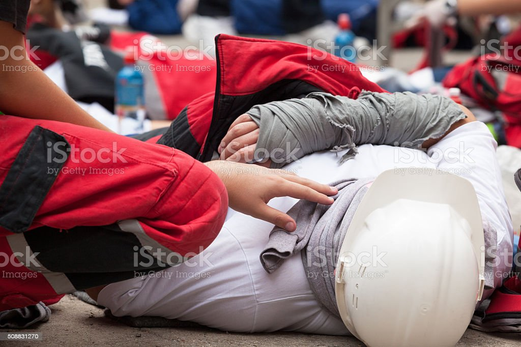 Work accident. First aid training. stock photo