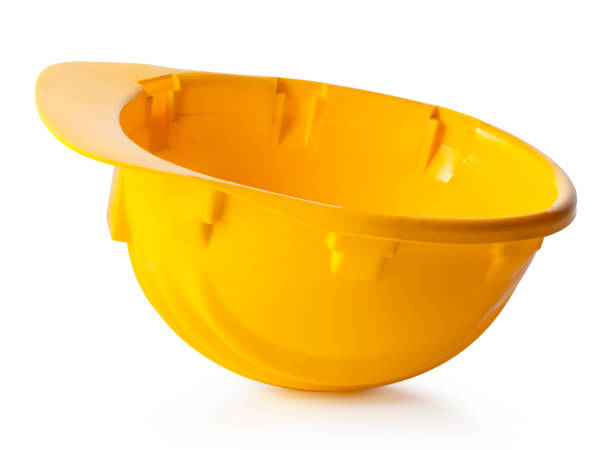 Work accident. Yellow safety helmet upside-down on white background. Photo with clipping path. stock photo