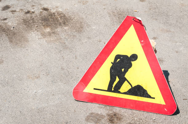 Work ahead caution or warning traffic road sign on the street - foto stock