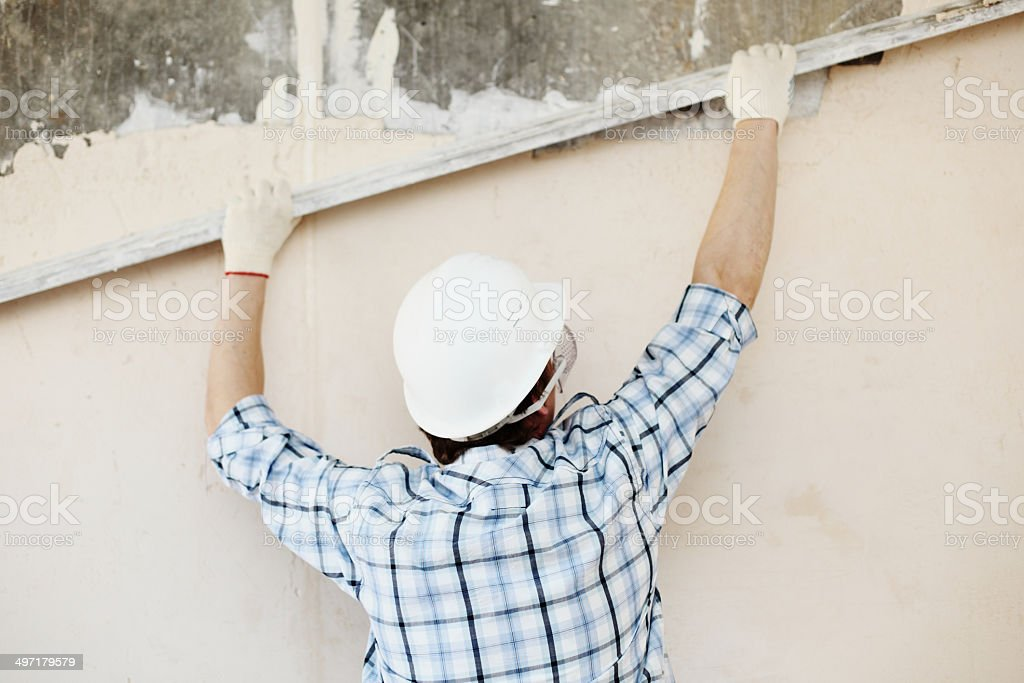 work aligns with a spatula wall stock photo