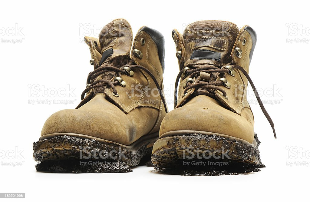 Work boots and mud stock photo