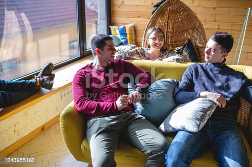 Young software development team relaxing in their lounge room