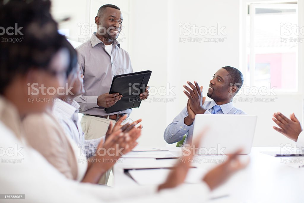 Work Colleagues Congratulating after presentation, South Africa royalty-free stock photo
