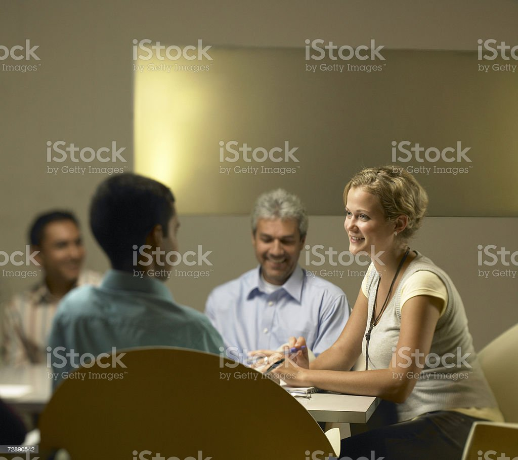 Work colleagues sitting together at meeting foto de stock royalty-free