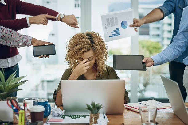 Work commitments are closing in on her Shot of a young businesswoman looking stressed out in a demanding office environment mental burnout stock pictures, royalty-free photos & images