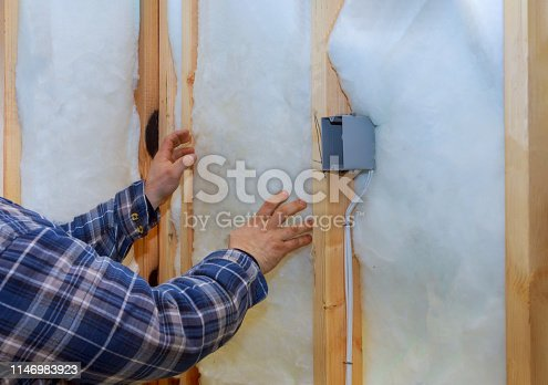 466705128 istock photo Work composed of mineral wool insulation in the wall heating insulation warm house, 1146983923