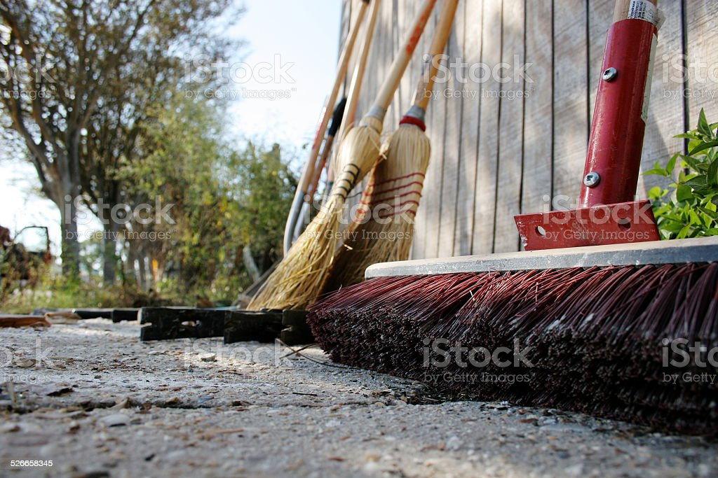Work, Construction, Clean Up tools outside leaning on a Barn stock photo